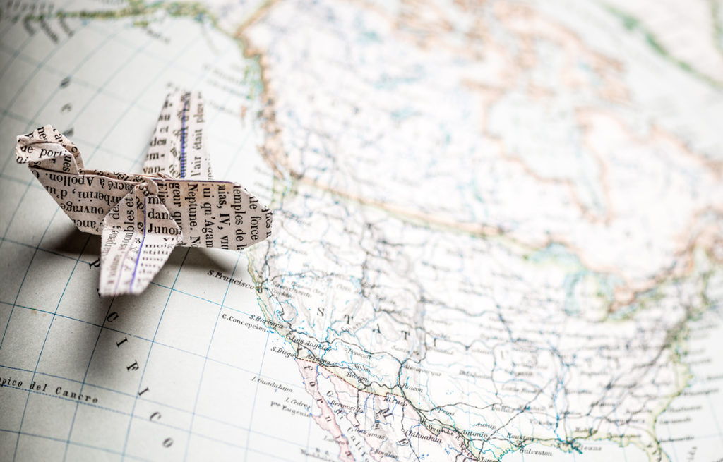 Paper Airplane placed on a map of the United States