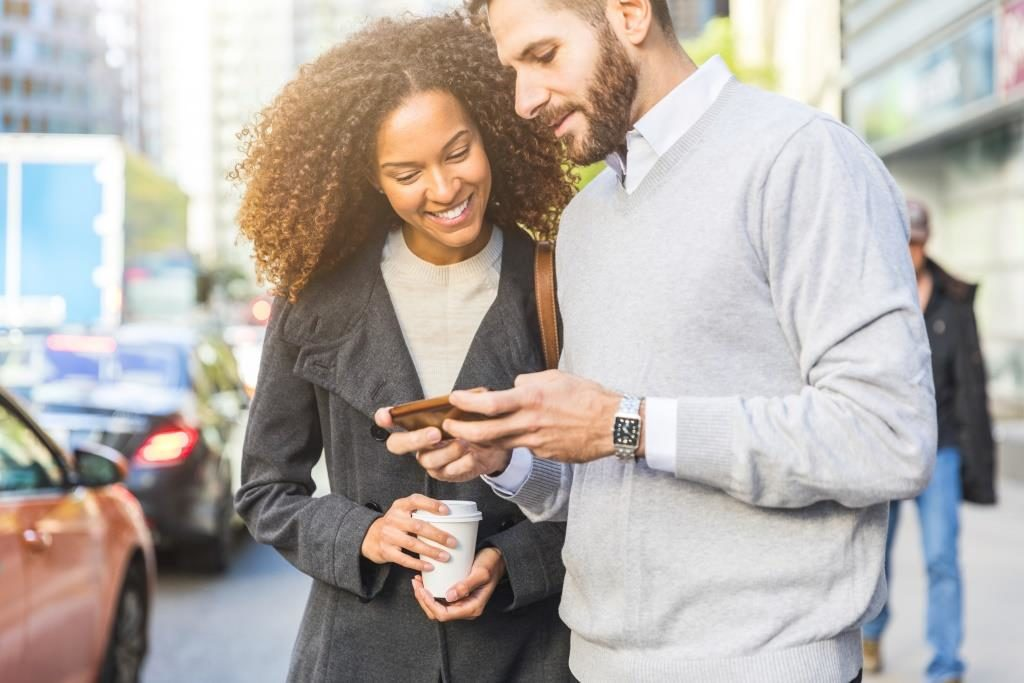 Man and woman on mobile phone