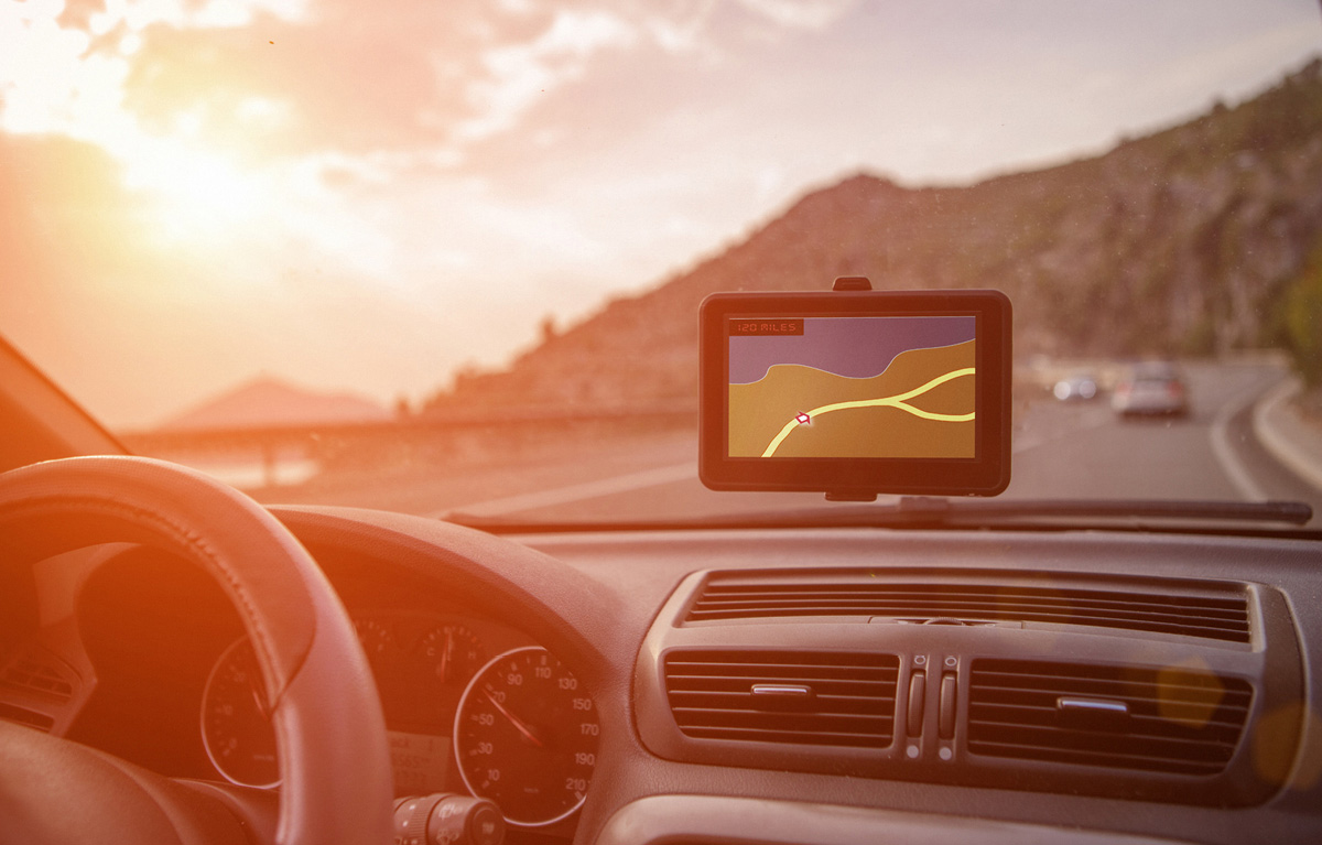 Dashboard view of a vehicle driving through the mountains using a GPS