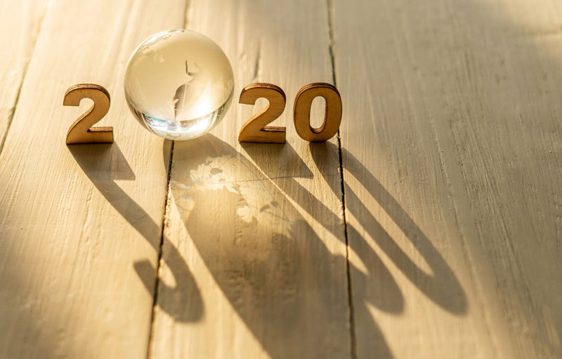 2020 text on the wooden floor for and the first zero is a glass ball