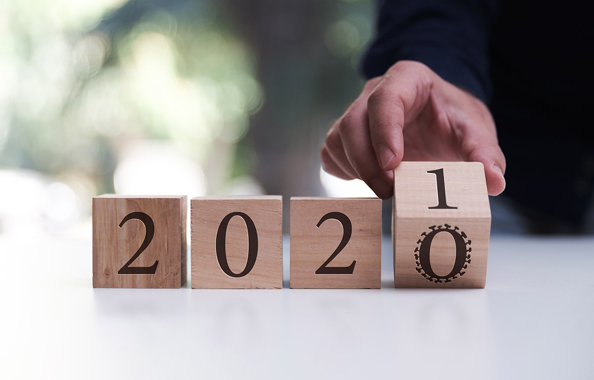 A closeup of a person turning over a cube to read from 2020 to 2021